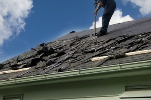 a roofer repairing a shingle roof, roof repair