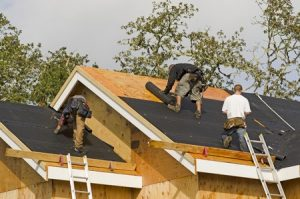 a roofing crew doing new roofing construction