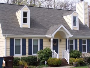 a house with a new shingle roof, residential roofing company