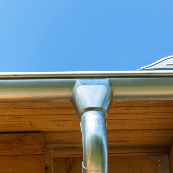 silver colored gutter system