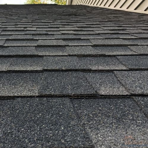 A Close Up Picture of Asphalt Shingles On a Roof.
