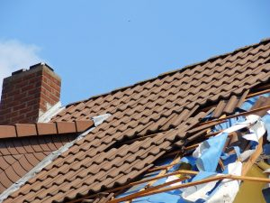 a storm damaged roof that needs hail damage repair
