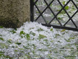 a pile of hailstones, hail damage