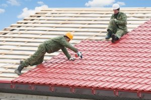 a photo of roofers doing a metal roof installation
