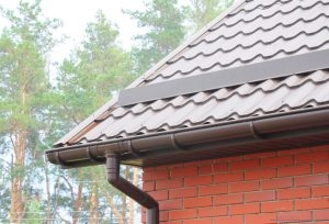 Metal Gutters Beneath Metal Shingle Roof